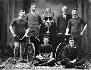 Waterford Bicycle Club team with their silverware. There's something very strange going on with all of their faces, but the trophies are far clearer in this one... Again, this one was ordered by a Mr Keane, who may have lived or worked on Henrietta Street, Waterford. Date: Sunday, 4 July 1909 NLI Ref.: P_WP_1944